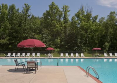 Large Swimming Pool at apartment in West Deptford with Lounge Chairs and Tables